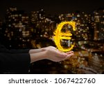 Hand With Euro Fire Icon Over...