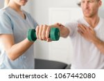 patient at the physiotherapy... | Shutterstock . vector #1067442080