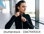 girl taking off tracksuit... | Shutterstock . vector #1067445314