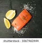 salmon fillet on black stone...   Shutterstock . vector #1067462444