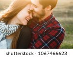 smiling couple in love outdoors. | Shutterstock . vector #1067466623