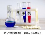 Small photo of poison of Russian origin: Signs of virulence on test tubes of the color of the Russian flag, beside a flask, tablets