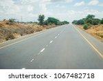 african tarmac road heat haze... | Shutterstock . vector #1067482718