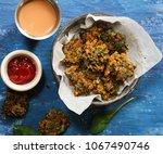 homemade palak pakoda   spinach ... | Shutterstock . vector #1067490746