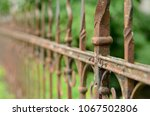 a decorated rusted iron fence | Shutterstock . vector #1067502806