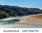 Small photo of A beautiful view with water, pebbles and hills in Manas National Park, Assam, India