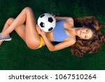 sexy cheerleader with a soccer...   Shutterstock . vector #1067510264