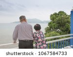 the old man looking at the sea...   Shutterstock . vector #1067584733