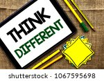 Small photo of Text sign showing Think Different. Conceptual photo Rethink Change on vision Acquire New Ideas Innovate written on Tablet on the jute background Pens Pencil and Sticky Note Papers