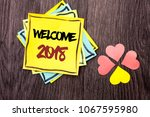 Small photo of Text sign showing Welcome 2018. Conceptual photo Celebration New Celebrate Future Wishes Gratifying Wish written on Stacked Sticky Note Papers on the wooden background Hearts next to it.