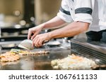 hand of man take cooking of... | Shutterstock . vector #1067611133