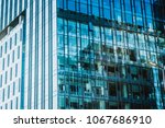 modern office building in urban | Shutterstock . vector #1067686910