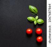 fresh cherry tomatoes and basil ... | Shutterstock . vector #1067687864