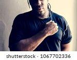 african descent man with hands... | Shutterstock . vector #1067702336