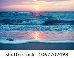 early morning sunrise on... | Shutterstock . vector #1067702498