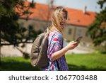 happy young woman is enjoying...   Shutterstock . vector #1067703488