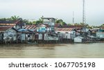 wooden house on the riverbank.... | Shutterstock . vector #1067705198