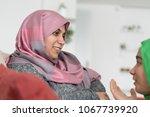 muslim mother and daughter... | Shutterstock . vector #1067739920