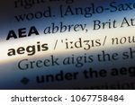 Small photo of aegis word in a dictionary. aegis concept.