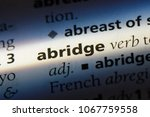 Small photo of abridge word in a dictionary. abridge concept.