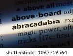 Small photo of abracadabra word in a dictionary. abracadabra concept.