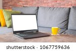 white screen laptop on a table... | Shutterstock . vector #1067759636