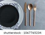 top view of black empty plate ... | Shutterstock . vector #1067765234