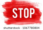 stop sign on paint brushed red... | Shutterstock .eps vector #1067780804