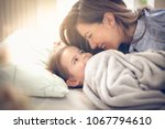 young mother with her little... | Shutterstock . vector #1067794610