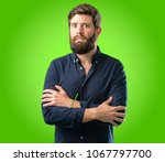 young hipster man with big... | Shutterstock . vector #1067797700