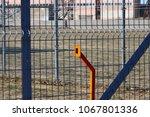 metal fence perimeter. gate...   Shutterstock . vector #1067801336