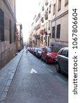 narrow street city view in... | Shutterstock . vector #1067806604