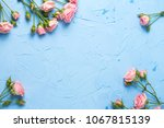 Stock photo frame from pink roses flowers on light blue textured background floral still life selective 1067815139