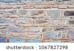 Small photo of Weathered stained old stone brick wall,red brick wall gradually wear away. eroded texture