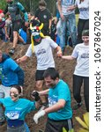 Small photo of Tyumen, Russia - August 8, 2015: Steel Character extrim race on Krugloe lake. Gagarin park in Cape district. Obstacle - Mud hole. Selection stage. Teams in action
