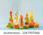 variety of fruit infused detox...   Shutterstock . vector #1067907068