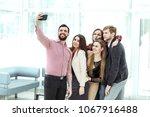 friendly business team taking a ... | Shutterstock . vector #1067916488