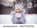 A Girl Playing With Snow In...