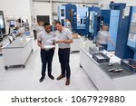engineers meeting on factory... | Shutterstock . vector #1067929880