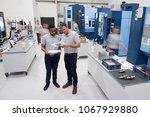 engineers meeting on factory... | Shutterstock . vector #1067929880