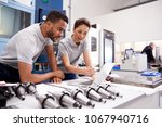 two engineers using cad... | Shutterstock . vector #1067940716