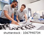 two engineers using cad... | Shutterstock . vector #1067940734