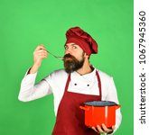 cook with attentive face in...   Shutterstock . vector #1067945360