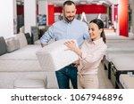 couple choosing folding... | Shutterstock . vector #1067946896