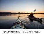 adventurous girl on a sea kayak ...   Shutterstock . vector #1067947580