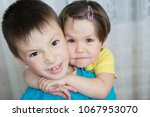 Small photo of animosity between brother and sister. siblings children portrait - boy and little girl, together. family portrait with different age kids. Domestic lifestyle. Childhood in family