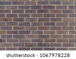 plain  purple  dark brick wall  ... | Shutterstock . vector #1067978228