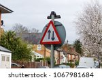a two way road sign  london  uk. | Shutterstock . vector #1067981684
