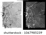 smashed clear glass on black... | Shutterstock . vector #1067985239