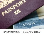close up of a visa document and ... | Shutterstock . vector #1067991869